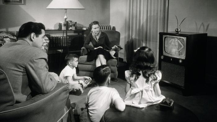 Watching television, c. 1955. A set like that would have cost around $200, or nearly $1,800 in 2016 dollars. Television was very much a middle class accessory, and as the middle class expanded in the Eisenhower era the audience expanded. What had been a play thing of the rich in a few cities in the mid-forties became the main source of entertainment and information for Middle America by the end of the fifties as people bought sets with their good credit.